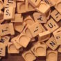 Scrabble tiles spilling from a bag