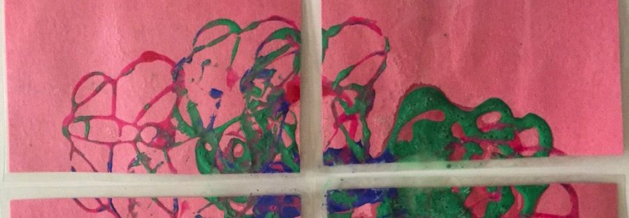 Cropped puzzle painting: green, blue and pink swirls on pink paper