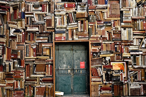 Door in a wall of books
