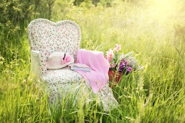 Floral chair in a field of long grass