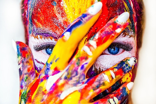 Woman with colourful paint all over her face